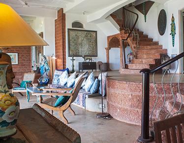 Charming Goa Boutique Hotel Sunset villa living room image 2